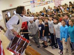 BETH REESE CRAVEY/Staff Joy Myers instructs Lakeside Elementary School students in the art of Revolutionary War military maneuvers, communicated through specific drum beats.